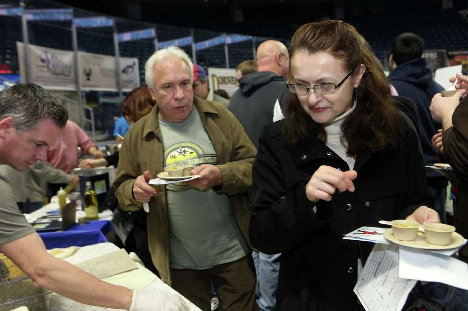 Eric and Kristin Woods, of Norwalk, taste soup at the 6th annual Chowdafest  at the Webster Bank Arena in Bridgeport, Conn. on Sunday, Feb. 2, 2014. Chowdafest benefits the Connecticut food bank. Photo: BK Angeletti, B.K. Angeletti / Connecticut Post freelance B.K. Angeletti