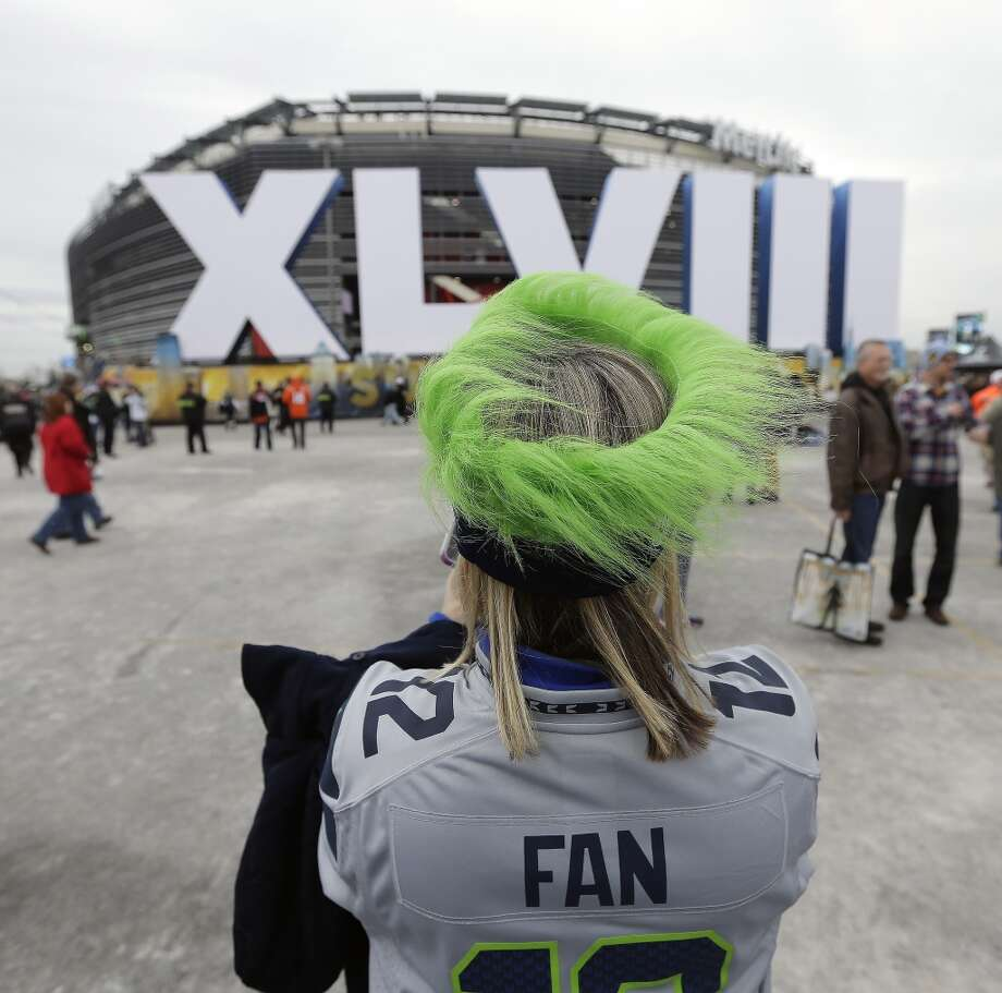 Seattle Seahawks fan Shirley Wolff, of Puyallup, Wash., takes a photo outside MetLife Stadium before the NFL Super Bowl XLVIII football game between the Seattle Seahawks and the Denver Broncos, Sunday, Feb. 2, 2014, in East Rutherford, N.J. (AP Photo/Charlie Riedel) Photo: AP