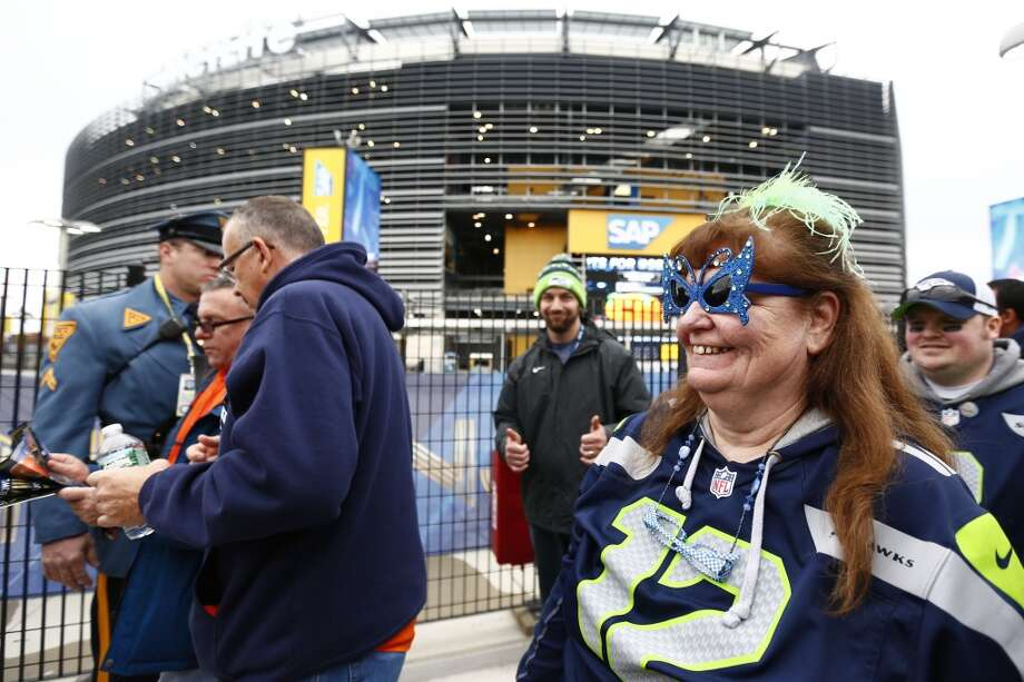 Football fans arrive at MetLife Stadium, Sunday, Feb. 2, 2014, in East Rutherford, N.J. The Seattle Seahawks are scheduled to play the Denver Broncos in NFL football's Super Bowl XLVIII game on Sunday evening. (AP Photo/Matt Rourke) Photo: AP