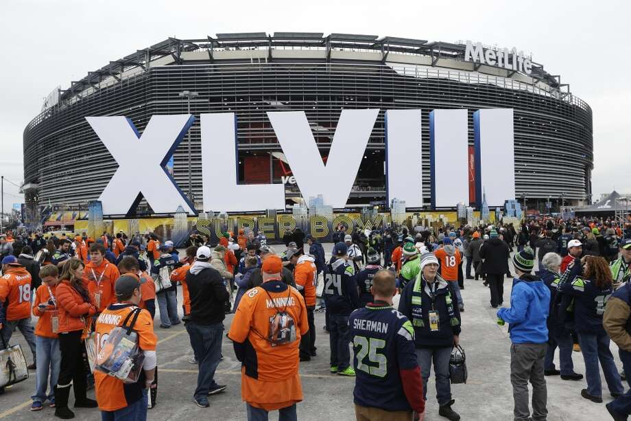 Fans arrive for the NFL Super Bowl XLVIII football game between the Seattle Seahawks and the Denver Broncos at MetLife Stadium Sunday, Feb. 2, 2014, in East Rutherford, N.J. (AP Photo/Seth Wenig) Photo: AP