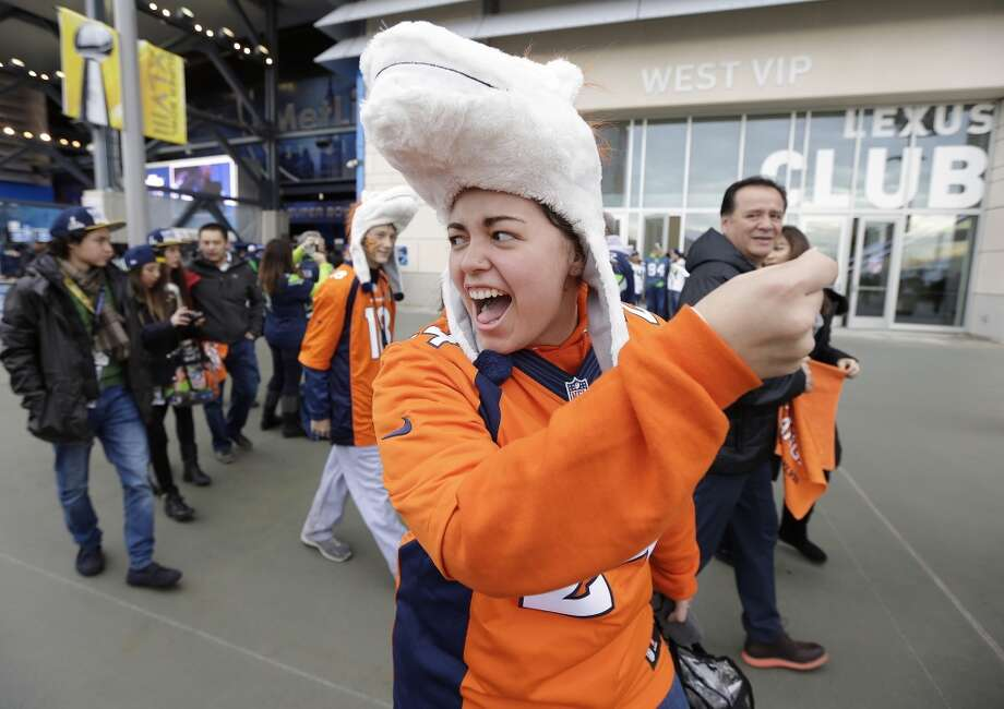 Denver Broncos fan Leinani Cagulada from Tustin, Calif., cheers before the NFL Super Bowl XLVIII football game between the Seattle Seahawks and the Denver Broncos, Sunday, Feb. 2, 2014, in East Rutherford, N.J. (AP Photo/Ted S. Warren) Photo: Ted S. Warren, AP