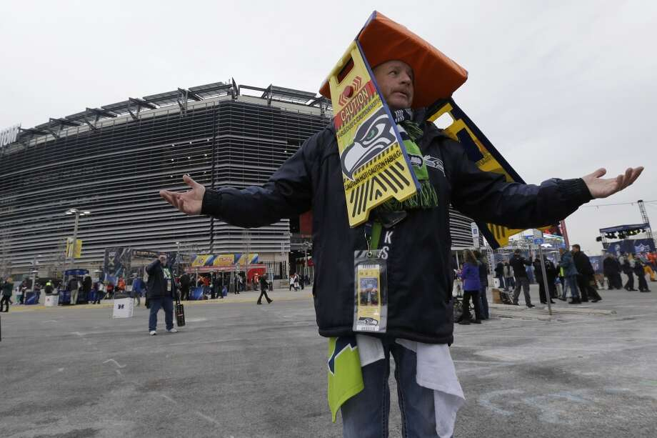 Ed Duncan, of Seattle, displays his outfit outside MetLife Stadium before the NFL Super Bowl XLVIII football game Sunday, Feb. 2, 2014, in East Rutherford, N.J. (AP Photo/Julio Cortez) Photo: AP