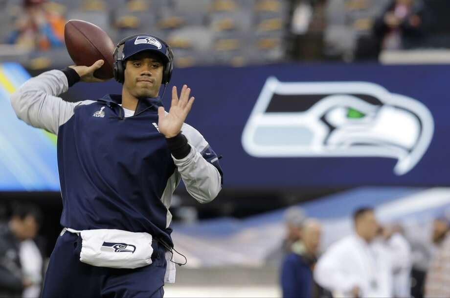 Seahawks quarterback Russell Wilson warms up before the start of the Super Bowl. Photo: Jeff Roberson, Associated Press