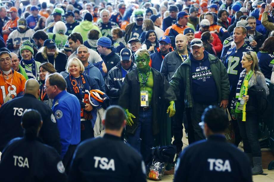 Football fans wait to go through security at the Secaucus Junction. Photo: Matt Rourke, Associated Press