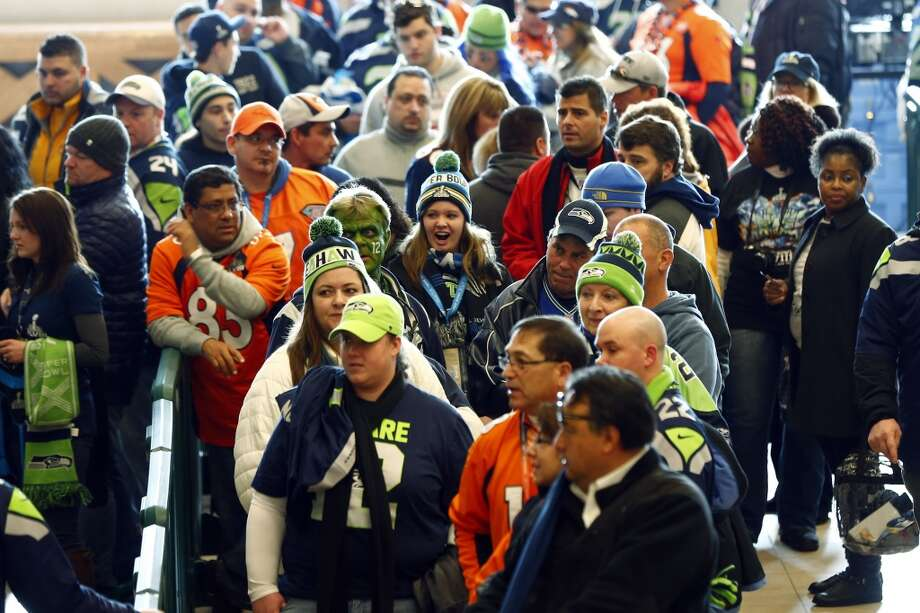 Football fans wait to go through security at the Secaucus Junction. Photo: Morry Gash, Associated Press