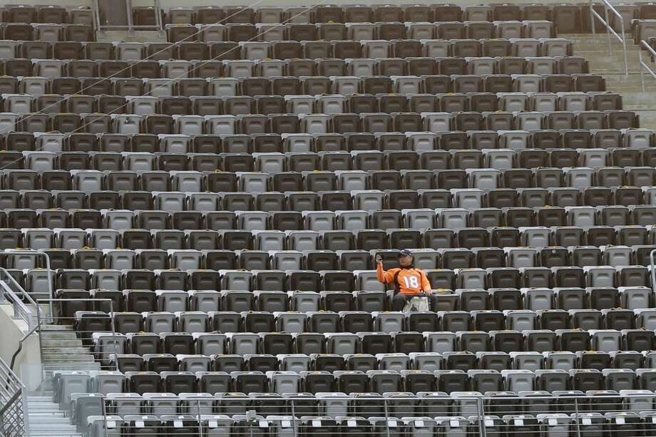 A Broncos fan takes a seat before the Super Bowl. Photo: Ben Margot, Associated Press