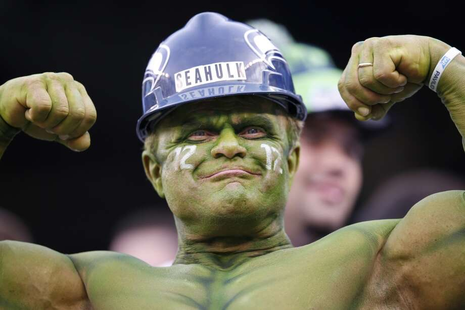 A Seahawks fan flexes at MetLife Stadium before the Super Bowl. Photo: Evan Vucci, Associated Press