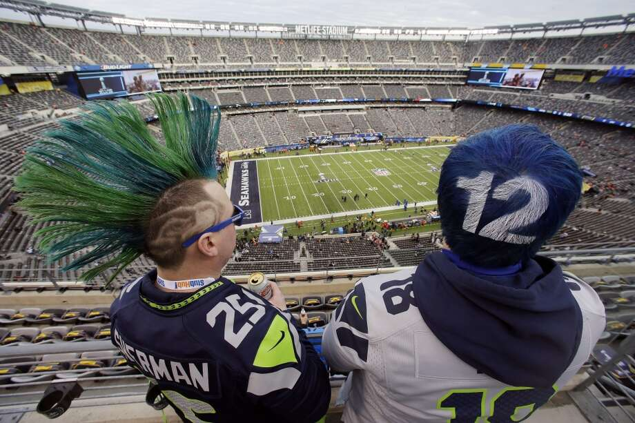 Two Seahawks fans before the start of the Super Bowl. Photo: Mel Evans, Associated Press