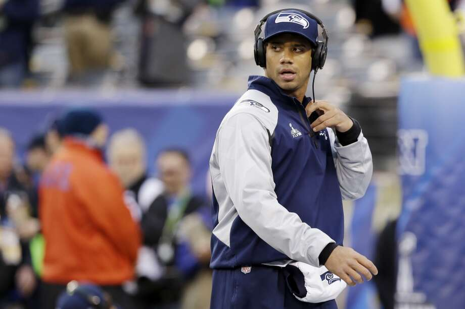 Seattle Seahawks' Russell Wilson walks across the field before the NFL Super Bowl XLVIII football game against the Denver Broncos Sunday, Feb. 2, 2014, in East Rutherford, N.J. (AP Photo/Julio Cortez) Photo: AP
