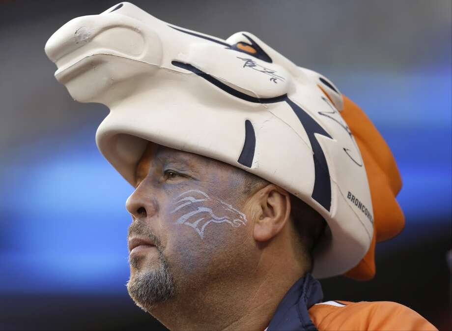 Steve Liedtke, of Denver, wears Denver Broncos  head gear before the NFL Super Bowl XLVIII football game between the Seattle Seahawks and the Denver Broncos on Sunday, Feb. 2, 2014, in East Rutherford, N.J. (AP Photo/Ben Margot) Photo: AP