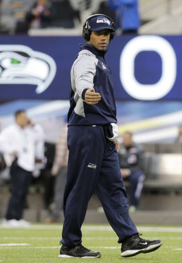 Seattle Seahawks quarterback Russell Wilson walks on the field before the NFL Super Bowl XLVIII football game against the Denver Broncos Sunday, Feb. 2, 2014, in East Rutherford, N.J. (AP Photo/Jeff Roberson) Photo: AP