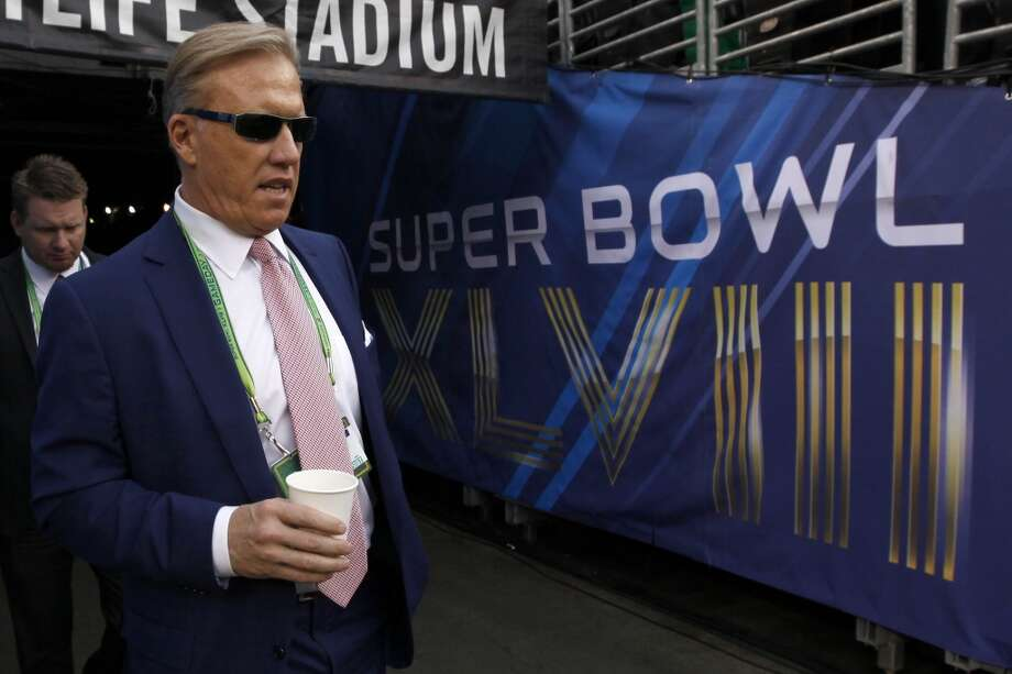 John Elway, Executive Vice President of the Denver Broncos, walks onto the field at MetLife Stadium before the NFL Super Bowl XLVIII football game between the Seattle Seahawks and the Denver Broncos on Sunday, Feb. 2, 2014, in East Rutherford, N.J. (AP Photo/Paul Sancya) Photo: AP