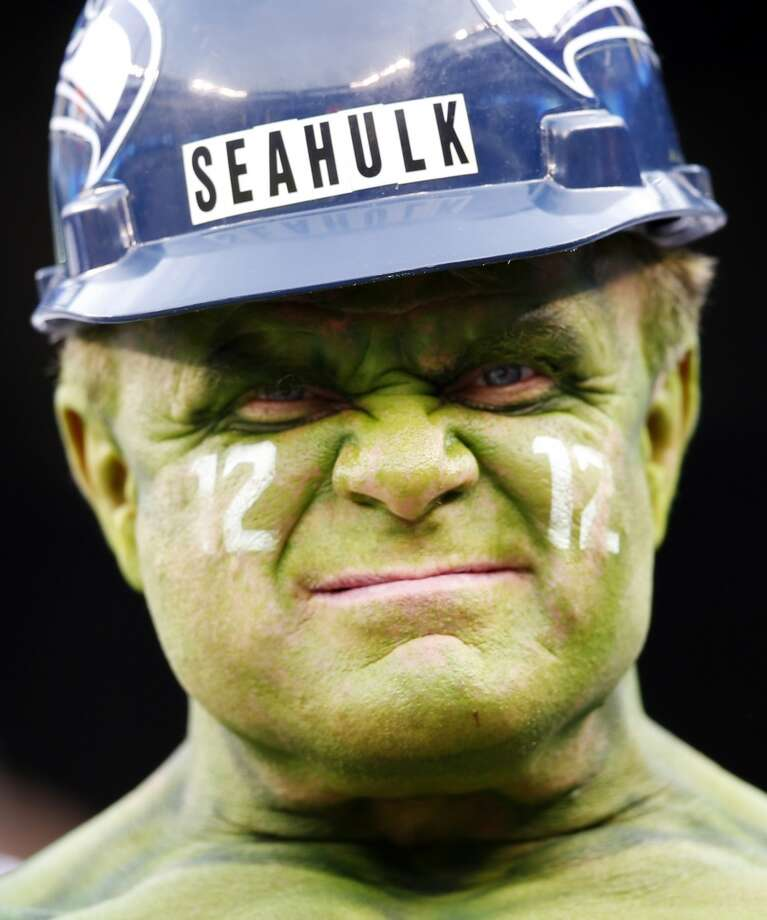A Seattle Seahawks fan poses before the NFL Super Bowl XLVIII football game between the Seahawks and the Denver Broncos, Sunday, Feb. 2, 2014, in East Rutherford, N.J. (AP Photo/Evan Vucci) Photo: Evan Vucci, AP