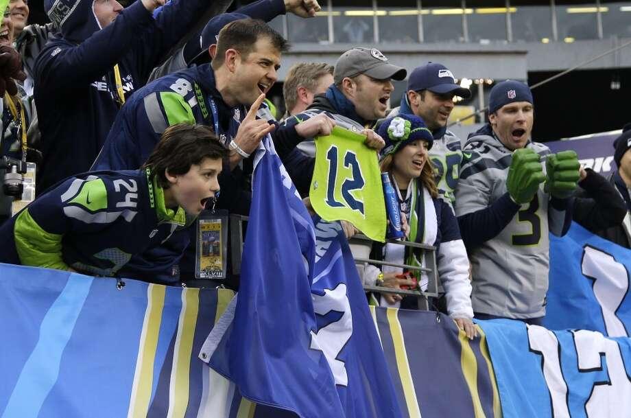 Seattle Seahawks fans cheer at MetLife Stadium before the NFL Super Bowl XLVIII football game between the Seattle Seahawks and the Denver Broncos Sunday, Feb. 2, 2014, in East Rutherford, N.J. (AP Photo/Matt Slocum) Photo: Matt Slocum, AP