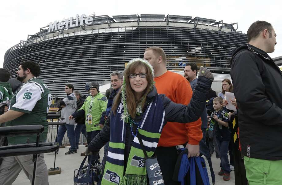 A Seattle Seahawks fan arrives at Meadowlands Rail Station before the NFL Super Bowl XLVIII football game between the Seattle Seahawks and the Denver Broncos on Sunday, Feb. 2, 2014, in East Rutherford, N.J. (AP Photo/Gregory Bull) Photo: Gregory Bull, AP
