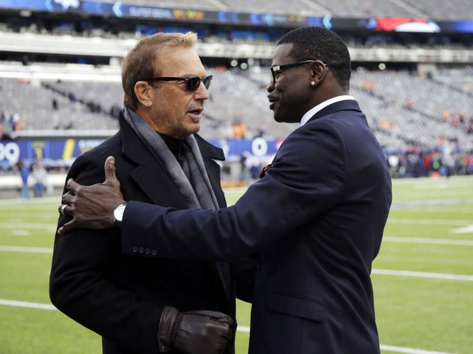 Actor Kevin Costner, left, greets NFL Network analyst Michael Irvin before the NFL Super Bowl XLVIII football game between the Seattle Seahawks and the Denver Broncos, Sunday, Feb. 2, 2014, in East Rutherford, N.J. (AP Photo/Matt Slocum) Photo: Matt Slocum, AP