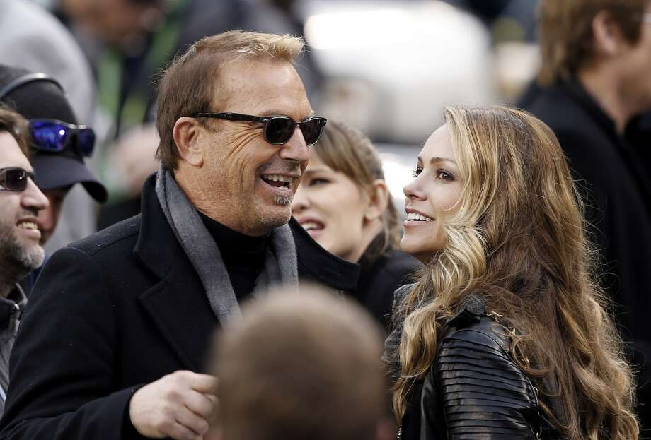 Actor Kevin Costner and his wife Christine Baumgartner arrive at the stadium before the NFL Super Bowl XLVIII football game between the Seattle Seahawks and the Denver Broncos on Sunday, Feb. 2, 2014, in East Rutherford, N.J. (AP Photo/Kathy Willens) Photo: Kathy Willens, AP