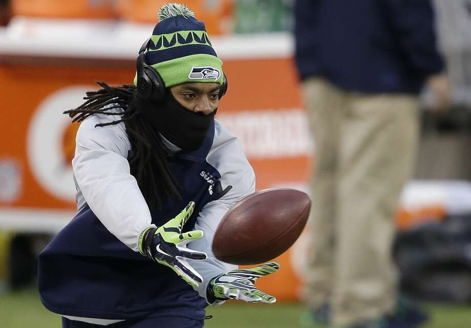 Seahawks cornerback Richard Sherman warms up before the Super Bowl. Photo: Gregory Bull, Associated Press