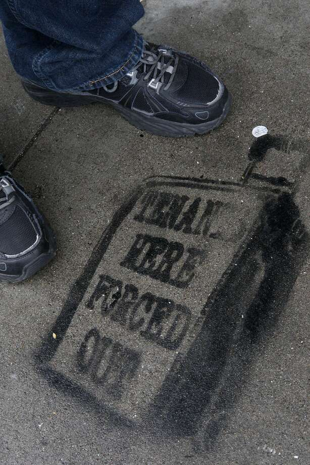 Someone created a sidewalk stamp outside the S.F. building where Tom Rapp received an Ellis Act eviction notice. Photo: Liz Hafalia, The Chronicle