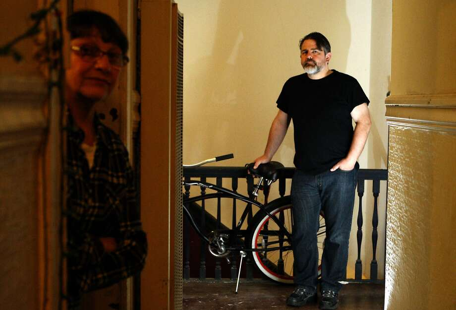 Patricia Kerman and Tom Rapp were served an Ellis Act eviction notice in August for the apartment they share in the Mission District. They will have to move out by the end of the summer. Photo: Liz Hafalia, The Chronicle