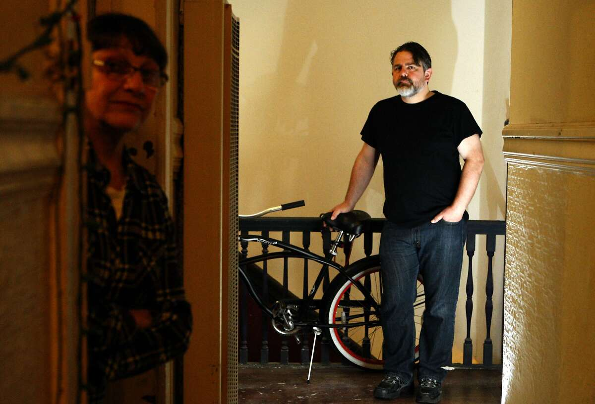 Patricia Kerman (left) and her roommate Tom Rapp (right) were served an Ellis Act eviction notice last August as they talk about it in their apartment in San Francisco, Calif., on Sunday, February 2, 2014.