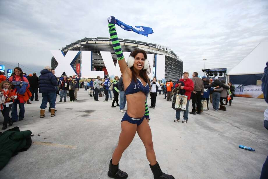 Susi Naficy, of Bellevue, Wash. who, on a bet, braves the weather outside of MetLife Stadium at Super Bowl XLVIII Sunday, Feb. 2, 2014, in New Jersey. (Joshua Trujillo, seattlepi.com) Photo: JOSHUA TRUJILLO, SEATTLEPI.COM