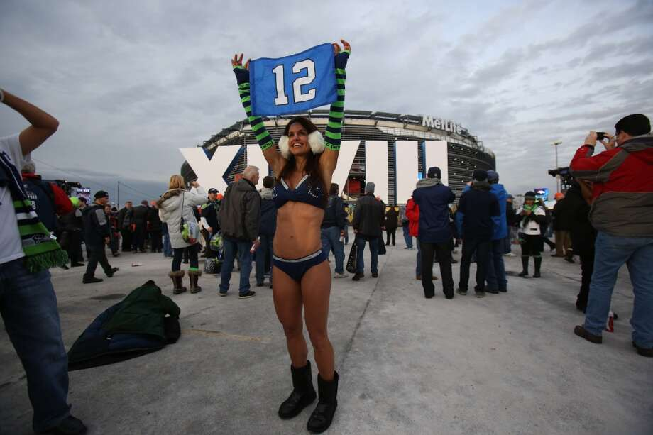 Susi Naficy, of Bellevue, on a bet, braves the weather outside of MetLife Stadium at Super Bowl XLVIII Sunday, Feb. 2, 2014, in New Jersey. (Joshua Trujillo, seattlepi.com) Photo: JOSHUA TRUJILLO, SEATTLEPI.COM