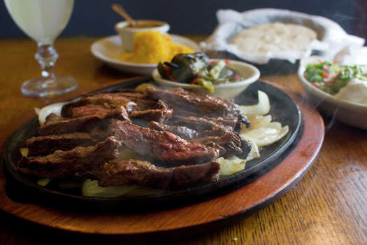 Marinated and grilled beef skirt steak fajitas at Ninfa's on Navigation, which has been featured on Food Network's 'The Best Thing I Ever Ate.' Photo: Johnny Hanson, Houston Chronicle / Houston Chronicle
