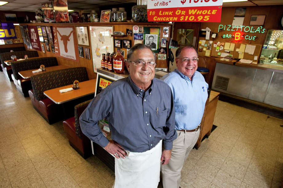Pizzitola's Bar B Cue owners Jerry Pizzitola, left and Tim Taylor. Their barbecue joint was featured on Cooking Channel's 'Road Trips with G. Garvin.' Photo: Nick De La Torre, Houston Chronicle / © 2011  Houston Chronicle