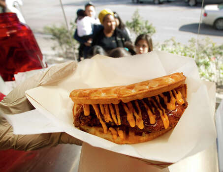 A chicken and waffles sandwich with spicy mayo as served by The Waffle Bus, which was featured on Cooking Channel's 'Eat St.' Photo: Brett Coomer, Houston Chronicle / © 2012 Houston Chronicle