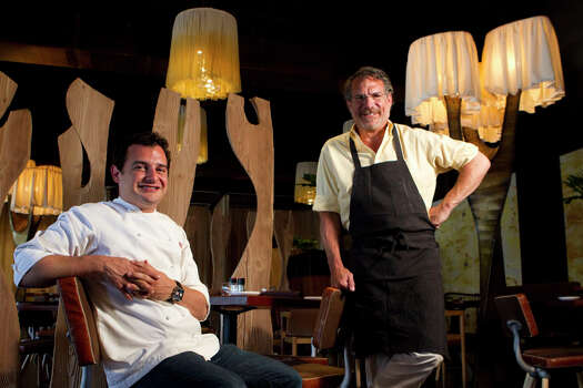 David Cordua, left, and his father, Michael, at Churrasco's, which was featured on Food Network's 'Diners, Drive-Ins and Dives.' Photo: Brett Coomer, Houston Chronicle / © 2012 Houston Chronicle