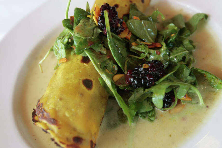 A crepe stuffed with butternut squash and avocado at Indika, which was featured on Food Network's 'Outrageous Food.' Photo: Billy Smith II, Chronicle / © 2013 Houston Chronicle