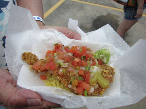 Tortilla-crusted tilapia with rice as served by St. John's Fire, a mobile kitchen that was showcased on Cooking Channel's 'Eat St.' Photo: Syd Kearney, Houston Chronicle