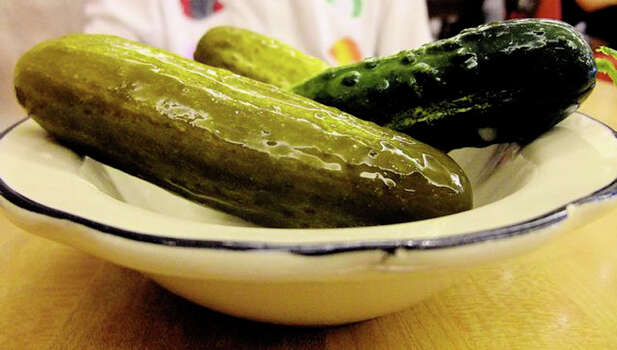 Kenny & Ziggy's sour & half-sour pickles. The deli was featured on Food Network's 'Diners, Drive-Ins and Dives.' Photo: Alison Cook, Houston Chronicle / Houston Chronicle