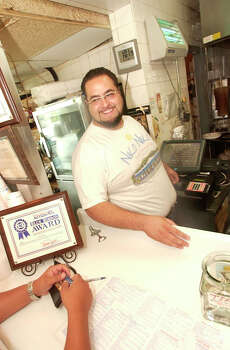 Demitrios Fetokakis working the counter at Niko Niko's, which was featured on Food Network's 'Diners, Drive-Ins and Dives.' Photo: BILL OLIVE, FOR THE CHRONICLE / FREELANCE
