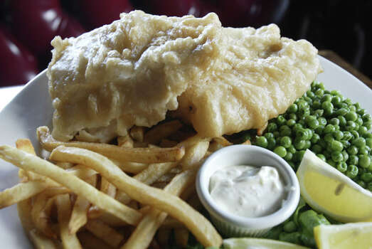 The fish and chips and Red Lion Pub, which was featured on Food Network's 'Diners, Drive-Ins and Dives.' Photo: D. Fahleson, Houston Chronicle / Houston Chronicle