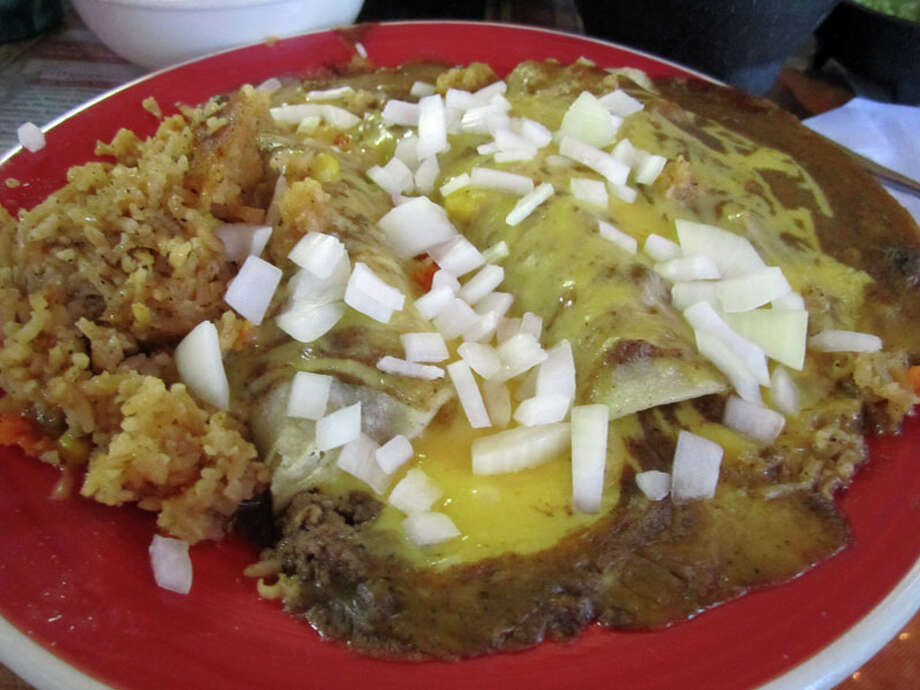A daily special, the cheese enchiladas, at Lankford Grocery, which was featured on Food Network's 'Diners, Drive-Ins and Dives.' Photo: Syd Kearney, Houston Chronicle / Houston Chronicle