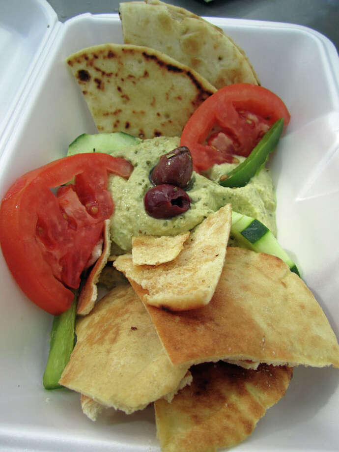 Hummus served picnic ready at Niko Niko's in Market Square Park. Fun fact: Niko Niko's was featured on 'Diners, Drive-Ins and Dives.' Photo: Syd Kearney, Houston Chronicle / Houston Chronicle