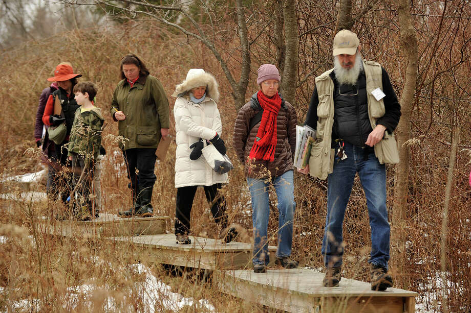 Ted Gilman, education specialist and naturalist, leads the way during the Insects in Winter Walk at the Audubon Center in Greenwich, Conn., on Sunday, Feb. 2, 2014. Photo: Jason Rearick / Stamford Advocate