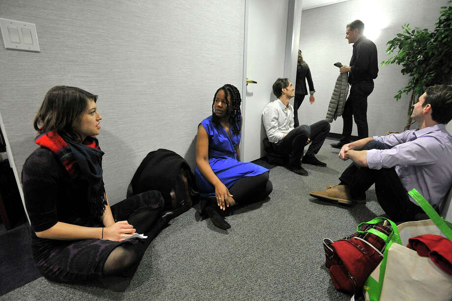 "From left, Stephanie Lane, Tangela Large, Ben Chase and Matt Russell sit in the hallway awaiting their turn to audition during try outs for Shakespeare on the Sound's production of ""Two Gentlemen of Verona"" at Office Suites of Darien in Darien, Conn., on Sunday, Feb 2, 2014. The play will be performed at Pinkney Park in Rowayton from June 13 to 29th. Photo: Jason Rearick / Stamford Advocate"