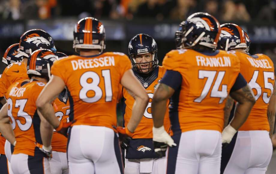 Peyton Manning and other members of the Broncos offense gather before the Super Bowl. Photo: Kevin C. Cox, Getty Images