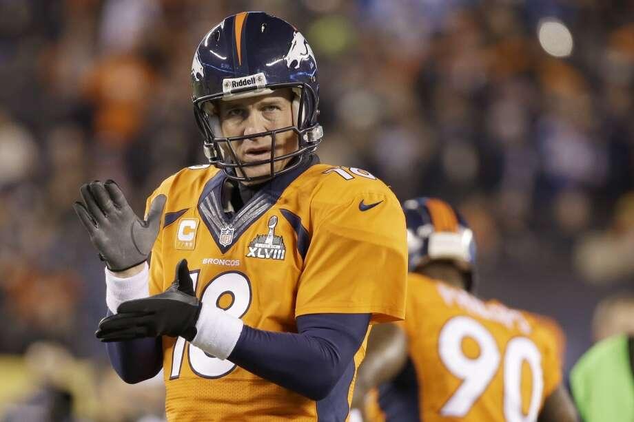 Broncos quarterback Peyton Manning warms up before the Super Bowl. Photo: Mark Humphrey, Associated Press