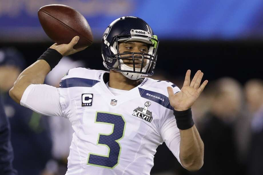 Seahawks quarterback Russell Wilson warms up before the Super Bowl. Photo: Julio Cortez, Associated Press