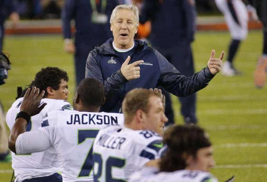 Seahawks coach Pete Carroll and Seattle players before the start of the Super Bowl. Photo: Matt York, Associated Press