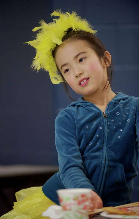 Kaylee Xie, 8, of Cheshire, waits to dance in a stage performance during the Western Connecticut Chinese Association's 2014 Chinese New Year celebration party, held at Newtown High School, Newtown, Conn, on Sunday, February 2, 2014. Photo: H John Voorhees III / The News-Times Freelance