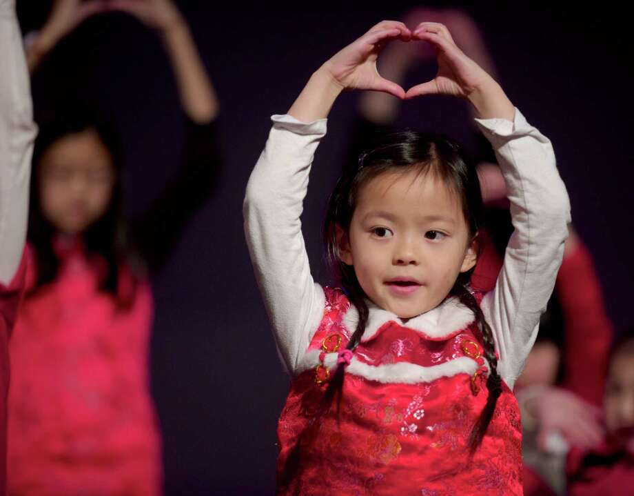 "Hannah Seo, 7, of New Milford, performs the song ""Live Out Love"" with a group from the Danbury Chinese Alliance Church during the Western Connecticut Chinese Association's 2014 Chinese New Year celebration party, held at Newtown High School, Newtown, Conn, on Sunday, February 2, 2014. The group was rehearsing for a performance later in the party. Photo: H John Voorhees III / The News-Times Freelance"