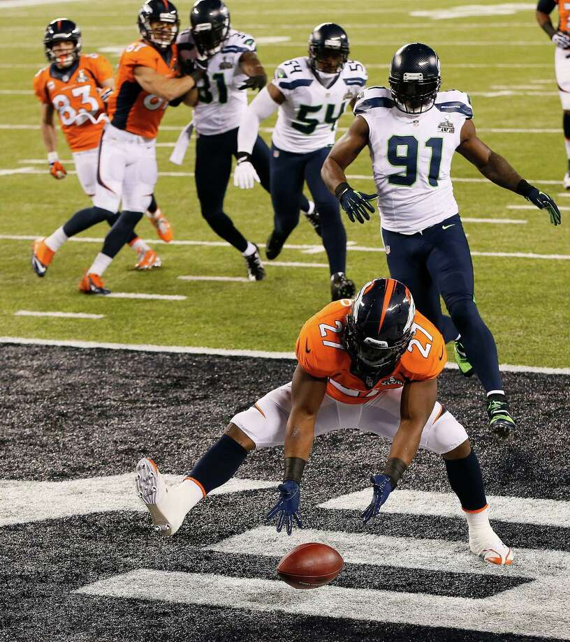 Denver Broncos running back Knowshon Moreno (27) recovers a fumble in the end zone for a safety after a bad snap in the first half of the NFL Super Bowl XLVIII football game against the Seattle Seahawks, Sunday, Feb. 2, 2014, in East Rutherford, N.J. Photo: Kathy Willens, AP / AP