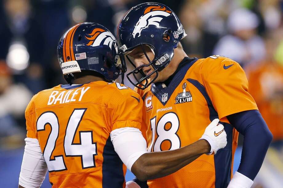 Denver Broncos' Champ Bailey, left, speaks with quarterback Peyton Manning before the NFL Super Bowl XLVIII football game against the Seattle Seahawks on Sunday, Feb. 2, 2014, in East Rutherford, N.J. (AP Photo/Paul Sancya) Photo: Paul Sancya, Associated Press