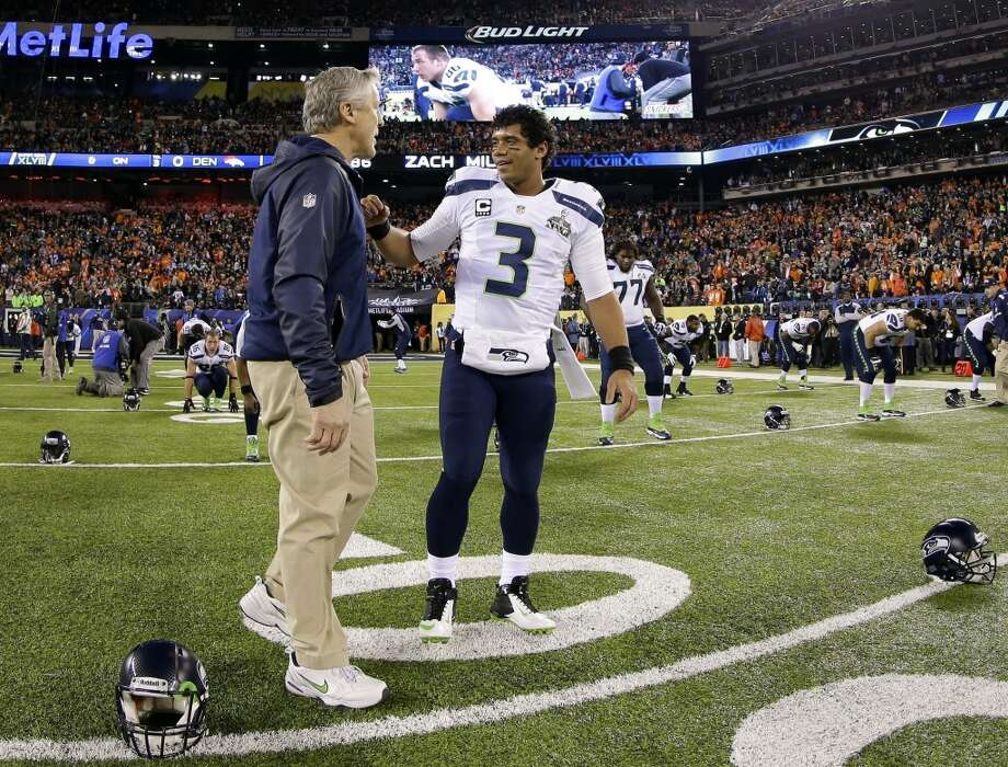 Seattle Seahawks quarterback Russell Wilson, right, talks with coach Pete Carroll before the NFL Super Bowl XLVIII football game against the Denver Broncos Sunday, Feb. 2, 2014, in East Rutherford, N.J. (AP Photo/Matt Slocum) Photo: Matt Slocum, Associated Press