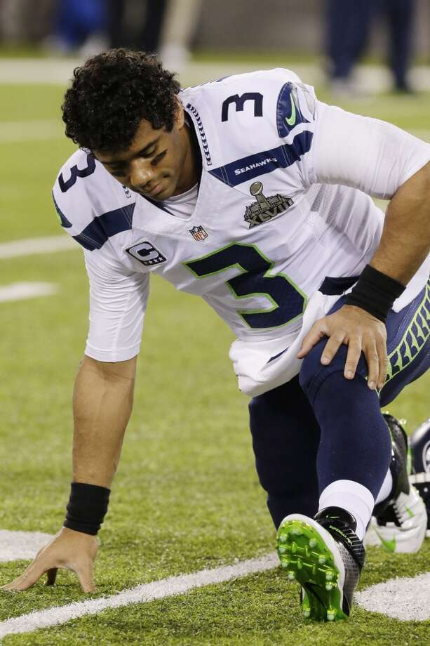 Seattle Seahawks' Russell Wilson stretches before the NFL Super Bowl XLVIII football game against the Denver Broncos Sunday, Feb. 2, 2014, in East Rutherford, N.J. (AP Photo/Julio Cortez) Photo: Julio Cortez, Associated Press